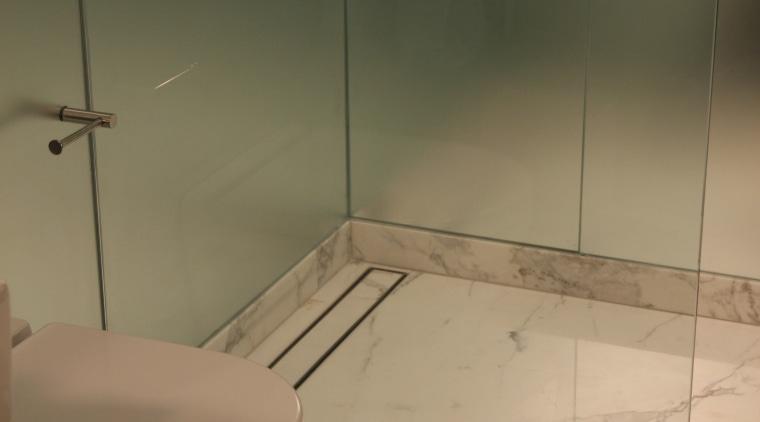 Lux Linear Drains produces decorative, pattern grate design bathroom, floor, flooring, plumbing fixture, property, room, tile, toilet, toilet seat, brown