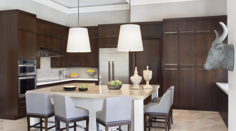 The large island provides ample room for several cabinetry, countertop, cuisine classique, dining room, interior design, kitchen, room, gray