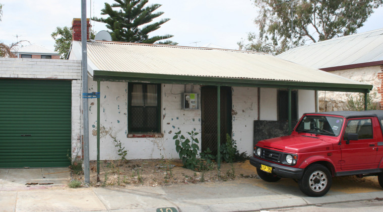 Before renovation the render on this cottage covered automotive exterior, car, family car, home, house, luxury vehicle, property, real estate, roof, shed, vehicle, white