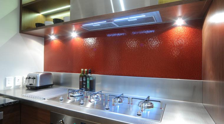 Kitchen designer Suyin says the extra-long Smeg Linea countertop, glass, interior design, kitchen, red, gray