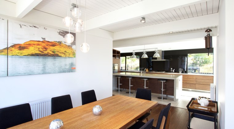 A black backpainted glass splashback, concrete island, and interior design, kitchen, property, real estate, white