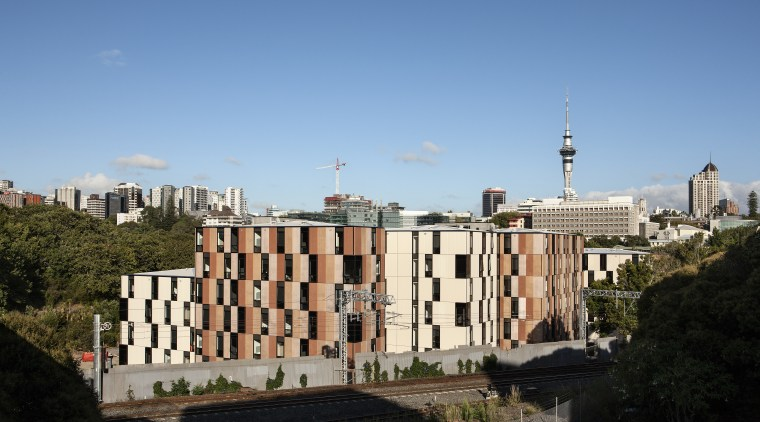 Carlaw Park Student Village in Auckland accommodates students architecture, building, city, cityscape, daytime, downtown, landmark, metropolis, metropolitan area, neighbourhood, residential area, roof, sky, skyline, skyscraper, tower block, tree, urban area, teal, black