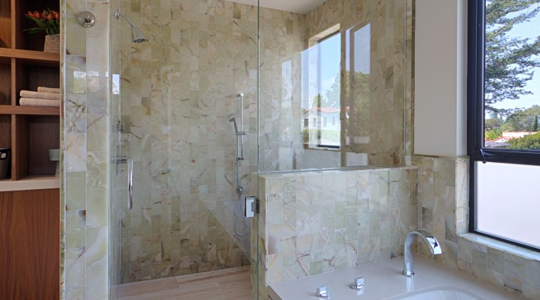 The shower is lined with onyx tiles. To architecture, bathroom, daylighting, estate, floor, flooring, home, interior design, real estate, room, tile, wall, window, gray