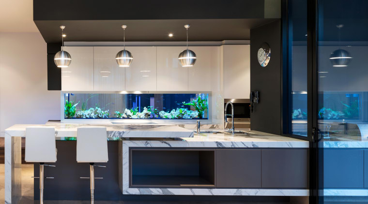This award-winning kitchen by AG Constructions has a countertop, home appliance, interior design, kitchen, black, gray
