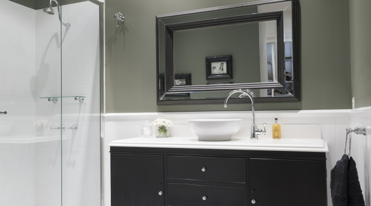 This black-and-white bathroom is in a house that bathroom, countertop, floor, flooring, home, interior design, kitchen, room, sink, gray, white, black
