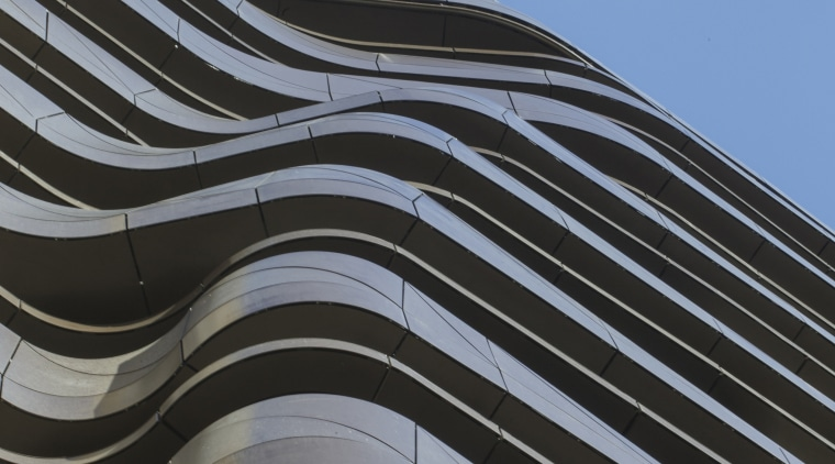 The undulating form of the aluminium-clad balconies on angle, architecture, building, daytime, facade, landmark, line, roof, sky, structure, black, teal
