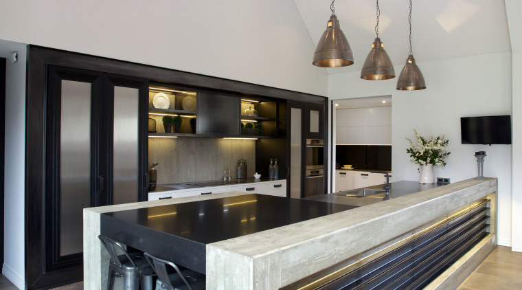 Solid concrete frames the 5.4m-long island in this countertop, floor, furniture, interior design, kitchen, table, gray