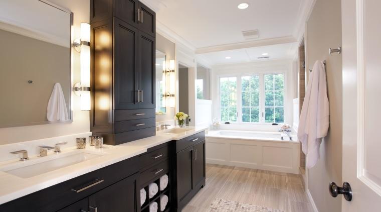 A long dark mahogany vanity provides plenty of bathroom, cabinetry, countertop, estate, home, interior design, kitchen, property, real estate, room, sink, gray