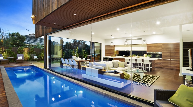 The lap pool butts up against a contemporary apartment, architecture, condominium, estate, home, house, interior design, leisure, property, real estate, swimming pool