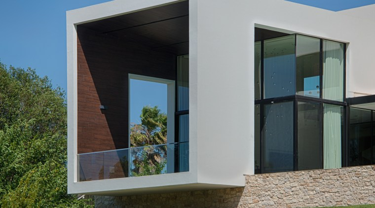 Cantilevered portal in new house by architect Mark architecture, building, daytime, elevation, facade, grass, home, house, real estate, residential area, sky, window, brown