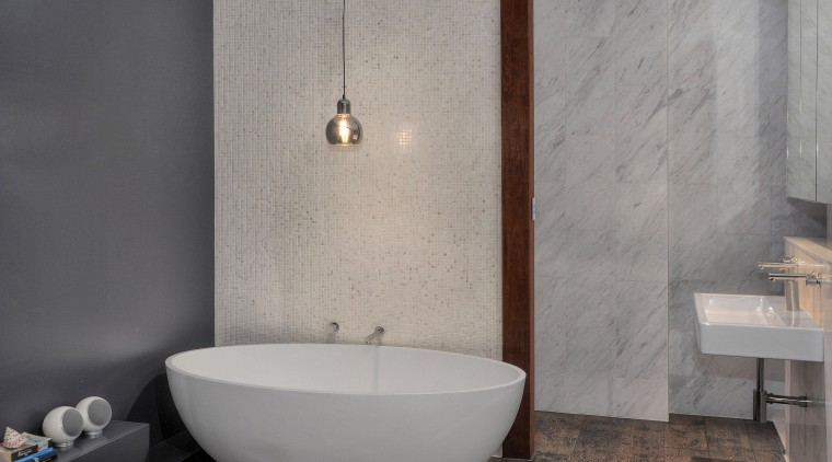 A mosaic blade wall hides the toilet and bathroom, bathroom sink, bidet, ceramic, floor, flooring, interior design, plumbing fixture, product design, room, sink, tap, tile, wall, gray