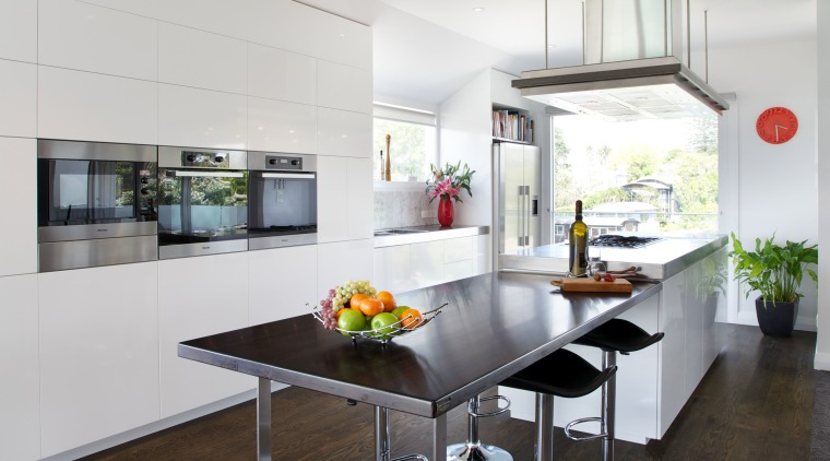 This contemporary kitchen, designed and manufactured by Mastercraft architecture, countertop, floor, flooring, house, interior design, kitchen, real estate, table, white, black