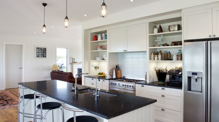 This traditionally styled kitchen, designed and manufactured by countertop, floor, flooring, hardwood, interior design, kitchen, room, wood flooring, gray