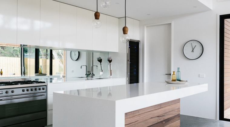 This kitchen combines white surfaces with timber finishes. architecture, cabinetry, countertop, cuisine classique, interior design, kitchen, real estate, gray
