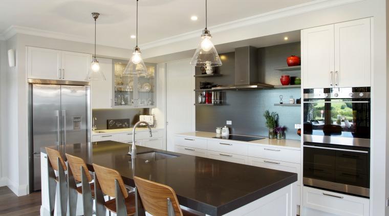 A dark splashback, charcoal grey  island benchtop countertop, cuisine classique, floor, flooring, interior design, kitchen, real estate, room, wood flooring, gray