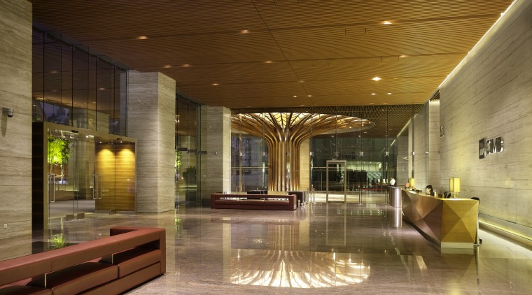 Bookmatched travertine marble walls line the lobby of architecture, ceiling, condominium, interior design, lighting, lobby, brown