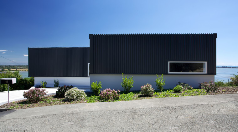 Designed by Archimetrix, a Christchurch-based consultancy, this new architecture, building, commercial building, corporate headquarters, facade, home, house, property, real estate, shed, sky, teal, gray
