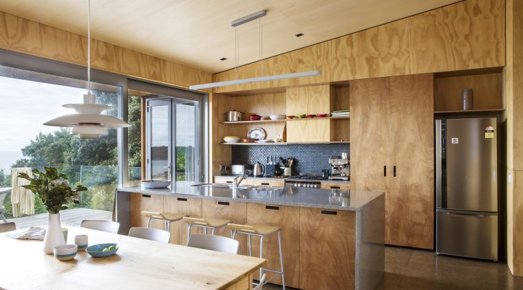 This new holiday home, designed and built by cabinetry, countertop, cuisine classique, interior design, kitchen, real estate, brown, white, orange