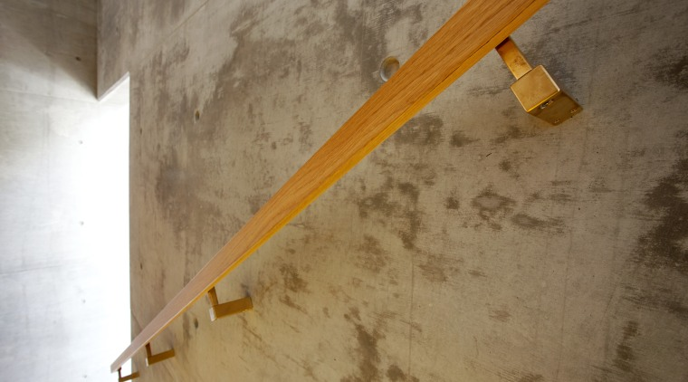 Satin brass stair rail brackets by Chant are ceiling, wall, wood, yellow, brown