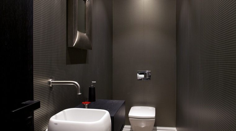A dark houndstooth-patterned wallpaper enhances the intimate feel architecture, bathroom, ceiling, floor, interior design, lighting, plumbing fixture, product design, public toilet, room, toilet, black, gray