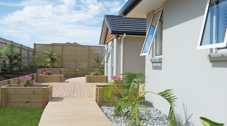 This new show home in Kerikeri is the architecture, cottage, deck, estate, facade, home, house, outdoor structure, property, real estate, residential area, siding, sky, walkway, wood