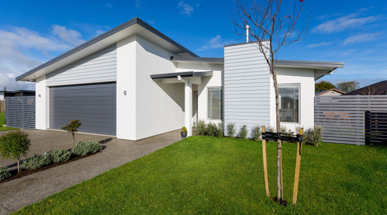 Two new homes by Fowler Homes Manawatu take building, cottage, elevation, estate, facade, grass, home, house, property, real estate, residential area, siding, sky, suburb, yard, brown