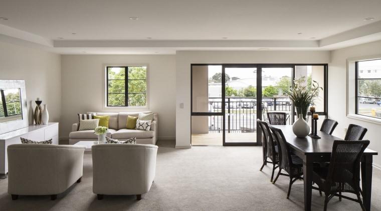 The design of Takapuna's The Poynton retirement village floor, flooring, home, house, interior design, living room, property, real estate, room, table, window, gray