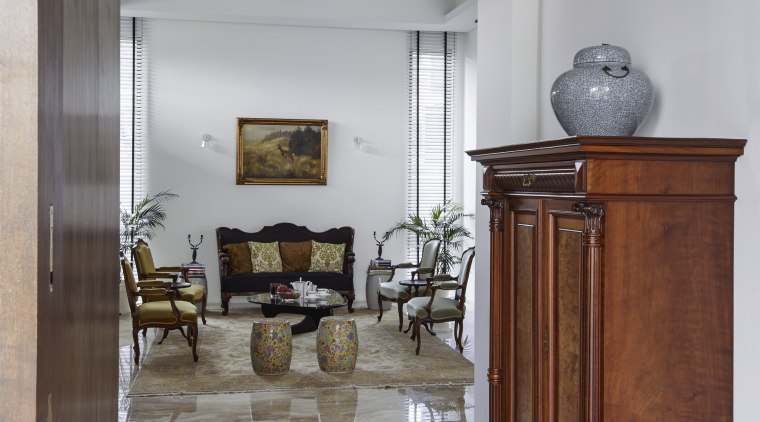 The interiors in this home reflect connections to ceiling, floor, flooring, furniture, hardwood, home, interior design, laminate flooring, living room, room, wall, wood, wood flooring, gray