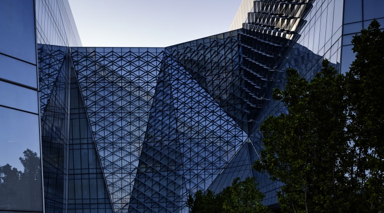 This new H-shaped Federal Office Building tenanted by architecture, building, city, cityscape, condominium, corporate headquarters, daytime, headquarters, landmark, metropolis, metropolitan area, reflection, sky, skyscraper, structure, tower block, urban area, black, blue