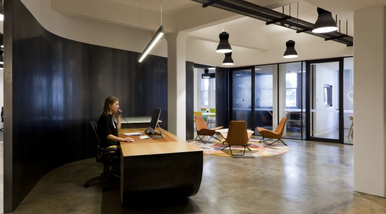 In this fit-out at Tanner Kibble Denton Architects's floor, flooring, furniture, interior design, loft, office, table, brown, black, gray