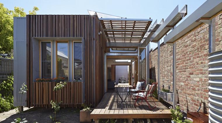 The Convertible Courtyards House by Christopher Megowan Design backyard, deck, facade, home, house, outdoor structure, property, real estate, siding, black