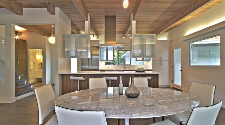 This reinvented kitchen forms part of a whole-house ceiling, dining room, estate, interior design, living room, real estate, table, gray, brown