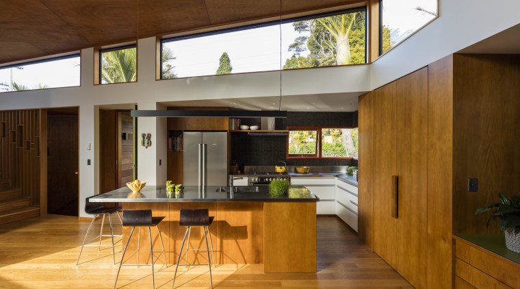 A variety of wood species feature in this architecture, countertop, hardwood, house, interior design, kitchen, wood, wood flooring, brown