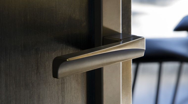 Arch Lever Handles by Chant were reworked to angle, product design, wood, brown, black