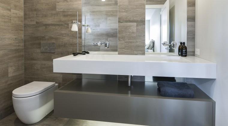 The look of timber plank tiles is matched bathroom, bathroom sink, ceramic, countertop, floor, flooring, interior design, plumbing fixture, product design, sink, tap, tile, gray