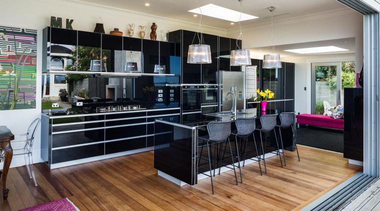 Even the splashback and countertop are in black flooring, interior design, kitchen, real estate, gray, black