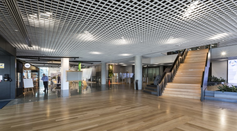 For an industrial touch, the foyer at the architecture, ceiling, daylighting, floor, flooring, interior design, lobby, gray
