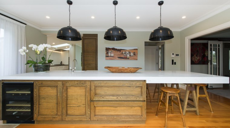 Crafted meets contemporary with this entertainer's kitchen island, cabinetry, countertop, cuisine classique, furniture, hardwood, interior design, kitchen, room, table, gray