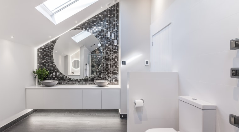 In this bathroom, a circular back lit mirror architecture, bathroom, daylighting, home, house, interior design, product design, sink, tap, gray, white