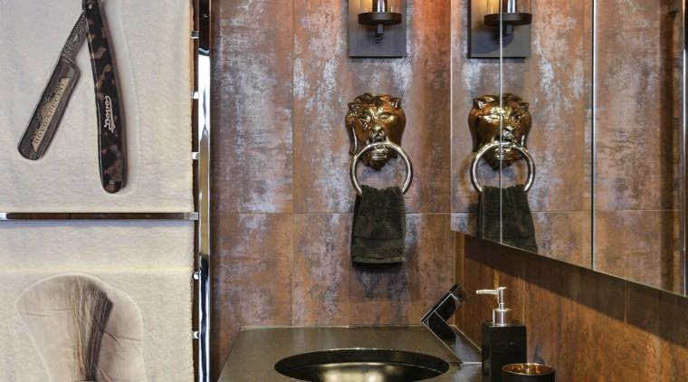 A sparkling black granite benchtop with black sinks bathroom, countertop, flooring, interior design, room, sink, brown