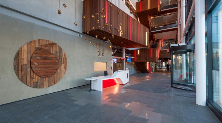 The Vodafone InnoV8 building's soaring atrium clad in architecture, floor, flooring, interior design, lobby, tourist attraction, gray