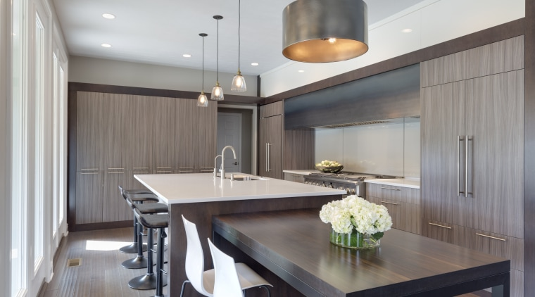 With cabinetry on two walls, a generous cooking ceiling, countertop, dining room, interior design, kitchen, real estate, gray