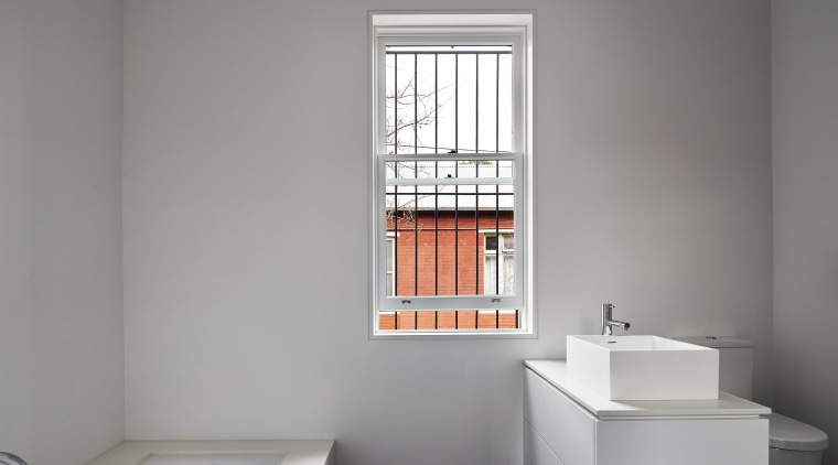The main bathroom in this addition is finished architecture, bathroom, bathroom accessory, daylighting, floor, interior design, plumbing fixture, product design, room, sink, tap, window, gray