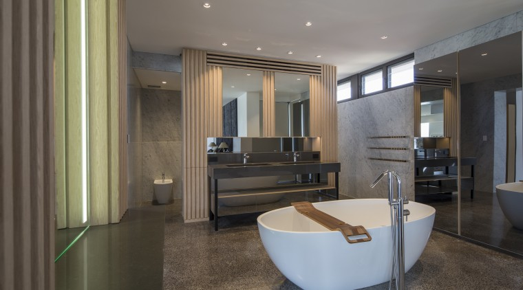 Strong and sculptural – this luxury ensuite by ceiling, floor, flooring, interior design, lobby, real estate, room, gray, black