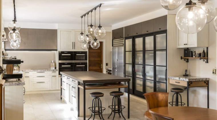 This renovated kitchen's large central island includes storage cabinetry, countertop, cuisine classique, interior design, kitchen, room, white