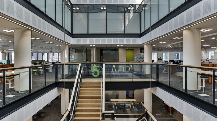 The atrium, stair, lifts and services in the apartment, architecture, building, commercial building, daylighting, interior design, lobby, metropolitan area, mixed use, shopping mall, gray, black