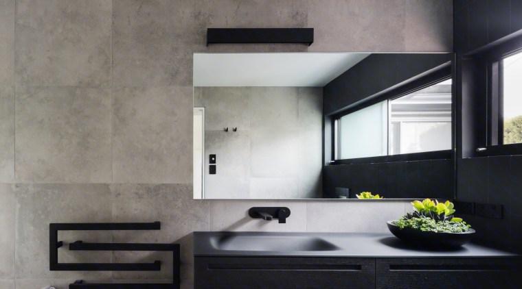 Add a dark, rich element with a black architecture, countertop, interior design, kitchen, sink, wall, gray, black