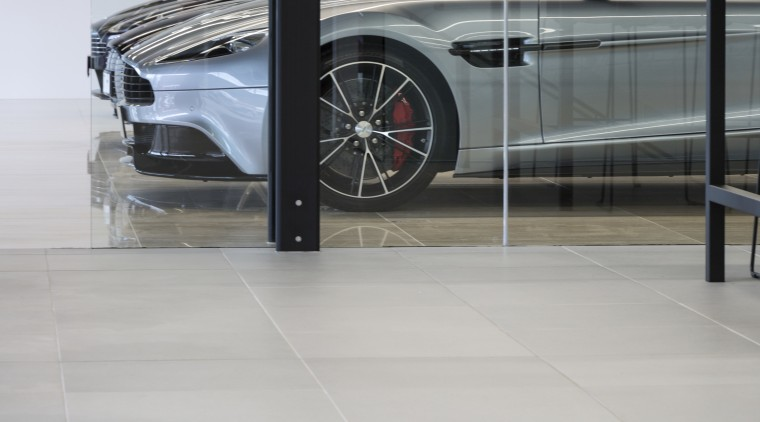 The new Giltrap building features large-format concrete pavers automotive design, automotive exterior, automotive wheel system, car, executive car, floor, flooring, luxury vehicle, motor vehicle, personal luxury car, vehicle, vehicle door, wheel, gray