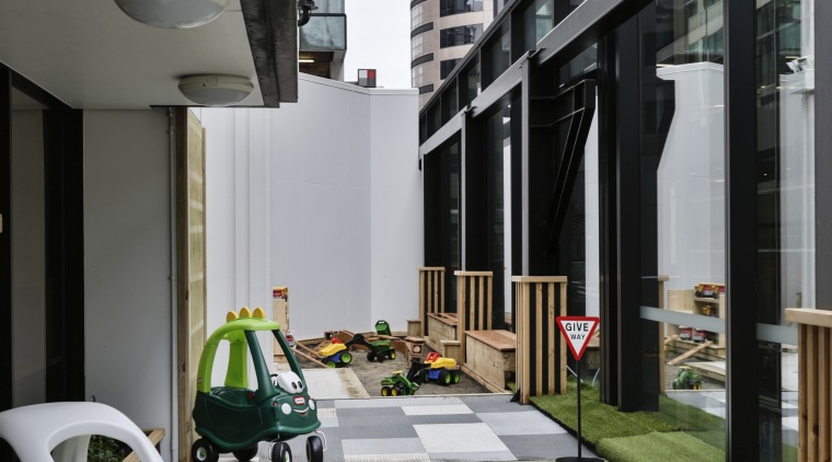 The outdoor area to the side of Cosmokids architecture, floor, house, gray, black