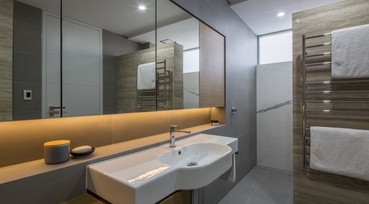 Under-lit mirror cabinets provide ample storage in this architecture, bathroom, floor, interior design, room, sink, gray